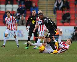 Cheltenham Town's Eliot Richards tackles the ball against Bury's Kelvin Etuhu- Photo mandatory by-line: Nizaam Jones - Mobile: 07966 386802 - 14/02/2015 - SPORT - Football - Cheltenham - Whaddon Road - Cheltenham Town v Bury - Sky Bet League Two