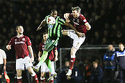 Tom Elliott of AFC Wimbledon and Zander Diamond of Northampton Town FC tussle during the Sky Bet League 2 match between Northampton Town and AFC Wimbledon at Sixfields Stadium, Northampton, England on 1 March 2016. Photo by Stuart Butcher.