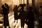 People in Pyin Oo Lwin train station as sunset light streams through