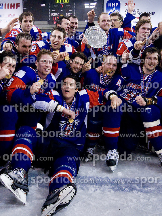Slovenian players posing with trophy after the match at IIHF Ice-hockey World Championships Division I Group B match between National teams of Hungary and Slovenia, on April 23, 2010, in Tivoli hall, Ljubljana, Slovenia. Slovenia defeated Hungary 4:1.  (Photo by Matic Klansek Velej / Sportida)