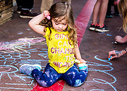 Young sidewalk artist at the Downtown Art District Association Gallery Hop in Winston-Salem, North Carolina