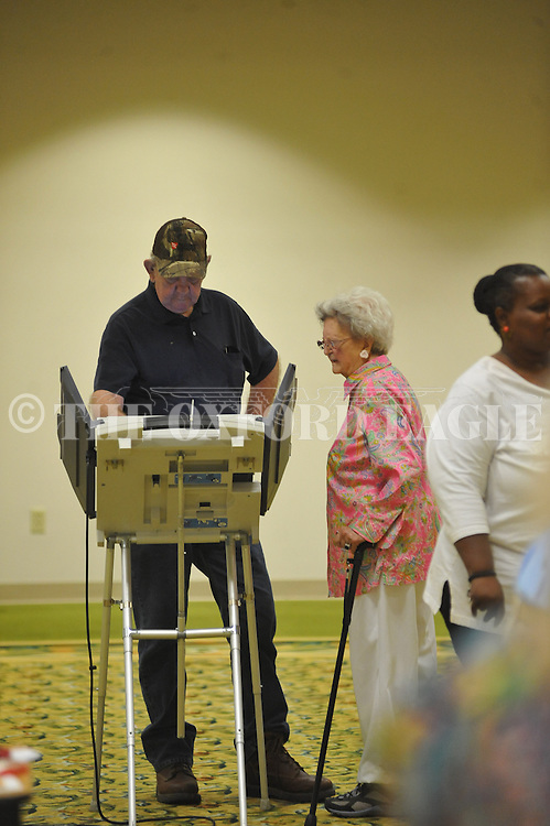 A man votes in the municipal election at the Oxford Conference Center in Oxford, Miss. on Tuesday, June 4, 2013.