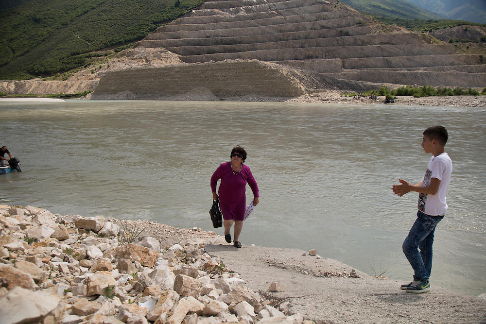 A family on a weekend excursion visits a hillside cut away at the Kalivach dam site on the Vjosa. The project has been halted for two years in the face of a corruption investigation against the company building the dam. If the government can move the dam out of the courts, construction could continue, blocking the Vjosa, says Zamir Dedej, general director of the National Agency of Protected Areas, newly established by the government.