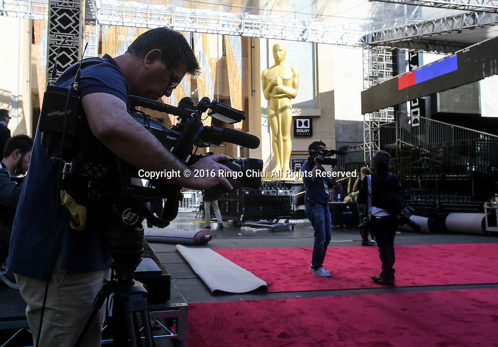 Media members cover the preparation for the Oscars in front of the Dolby Theatre in Los Angeles, Wednesday, February 24, 2016. The 88th Academy Awards will be held Sunday, February 28, 2016. (Photo by Ringo Chiu/PHOTOFORMULA.com)<br /> <br /> Usage Notes: This content is intended for editorial use only. For other uses, additional clearances may be required.