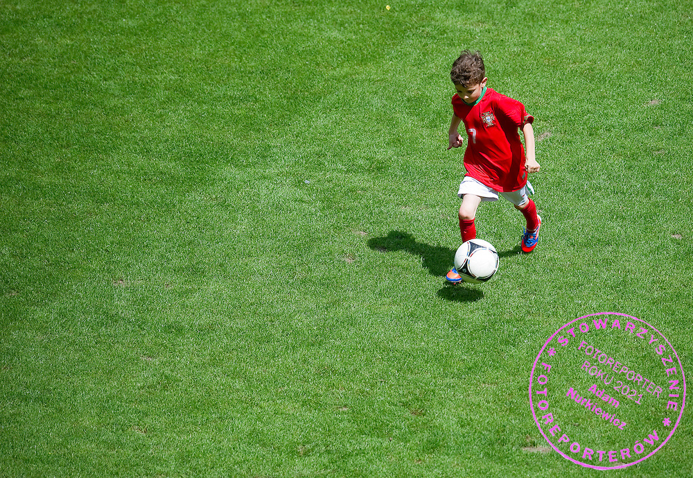 Kuba Zewlakow (son of Michal) play soccer before final match between SO Serbia (red) and SO Romania (white) during the 2013 Special Olympics European Unified Football Tournament in Warsaw, Poland.<br /> <br /> Poland, Warsaw, June 08, 2012<br /> <br /> Picture also available in RAW (NEF) or TIFF format on special request.<br /> <br /> For editorial use only. Any commercial or promotional use requires permission.<br /> <br /> <br /> Mandatory credit:<br /> Photo by © Adam Nurkiewicz / Mediasport