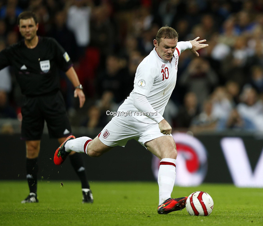 12.10.2012. Wembley Stadium, London, England.  Wayne Rooney r of England Scores From The Penalty Spot during The FIFA 2014 World Cup Group H Qualifying Match between England and San Marino AT Wembley  Stadium. England won the game by a score of 5-0.
