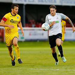 APRIL 1:  Dover Athletic against Bromley in Conference Premier at Crabble Stadium in Dover, England. Dover's forward Ryan Bird chases the ball towards goal closely watched by Bromely's Jack Holland. (Photo by Matt Bristow/mattbristow.net)