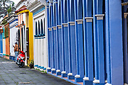 Colorful colonnade style buildings in Tlacotalpan, Veracruz, Mexico. The tiny town is painted a riot of colors and features well preserved colonial Caribbean architectural style dating from the mid-16th-century.