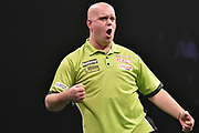 Michael van Gerwen celebrates during the Betway Premier League Darts at the Manchester Arena, Manchester, United Kingdom on 23 March 2017. Photo by Mark Pollitt.
