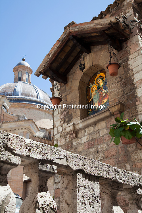 This beautiful, colourful depiction of Mary and Jesus, combined with the church and stone fence caught my immediate attention as we were exploring Assisi. It is one of my favorite photographs that I shot in Assisi, Italy.