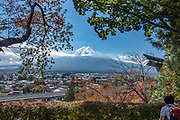 """See Mount Fuji (3776.24 m or 12,389 ft), the highest mountain in Japan, from Arakura Sengen Shrine in Fujiyoshida city, Yamanashi Prefecture, Honshu. This dormant stratovolcano last erupted in 1707–1708. Mount Fuji lies about 100 kilometers (60 mi) south-west of Tokyo, visible on a clear day. Its symmetrical cone is snow-capped for about 5 months a year. Mount Fuji is one of Japan's """"Three Holy Mountains"""" (Sanreizan). UNESCO recognizes 25 sites of cultural interest nearby."""