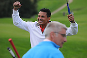 John Salako celebrates finishing the course during the Julian Speroni Testimonial Golf Day at the Surrey National Golf Club, Chaldon, United Kingdom on 9 September 2015. Photo by Michael Hulf.