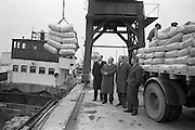 "11/02/1963<br /> 02/11/1963<br /> 11 February 1963<br /> Nitra-Shell 23 cargo discharged at New Ross, Co. Wexford. The ""M.V. Roelf Buisman"" from Rotterdam on it's first visit to New Ross delivering 500 ton of Nitra -Shell 23 the first consignment of 23% Nitrogen imported into Ireland. Messrs. Albatross Windmill Fertiliser Co. Ltd. were the importers. Picture shows, looking at some of the Nitra-Shell 23 (l-r): Mr. M. Murphy, Manager J.J. Stafford (New Ross);   Mr. J.J. Boyle, General Manager of Shell and Albatross (Agricultural) Ltd.; Mr. E.F. Storey, Managing Director, Albatross Windmill Fertiliser Co. Ltd. and Captain  Smith of the ""Roelf Buisman""."