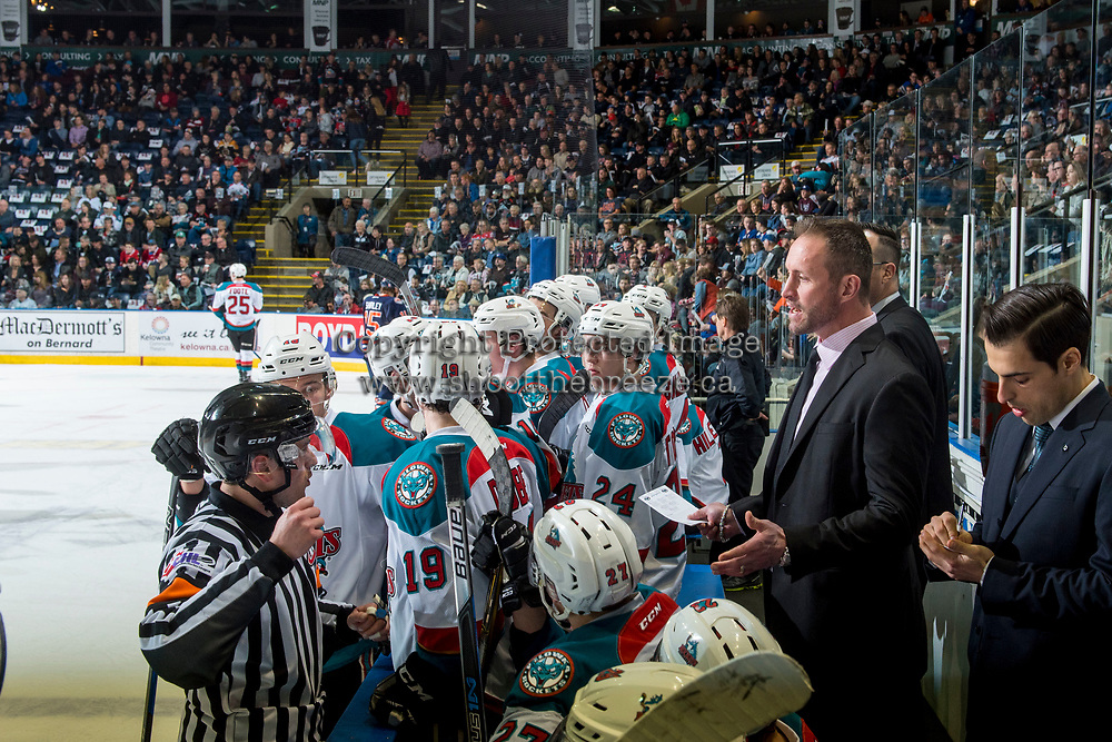 KELOWNA, CANADA - MARCH 24: Kelowna Rockets' head coach, Jason Smith stands on the bench and speaks to ice officials against the Kamloops Blazers on March 24, 2017 at Prospera Place in Kelowna, British Columbia, Canada.  (Photo by Marissa Baecker/Shoot the Breeze)  *** Local Caption ***