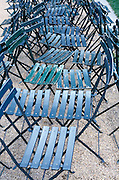 a row of folding chairs put together