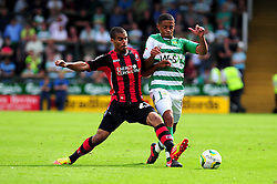 Bournemouth's Lewis Grabban challenges Yeovil Town's Nathan Ralph - Photo mandatory by-line: Dougie Allward/Josephmeredith.com  - Tel: Mobile:07966 386802 08/09/2012 - SPORT - FOOTBALL - League 1 -  Yeovil  - Huish Park -  Yeovil Town v AFC Bournemouth