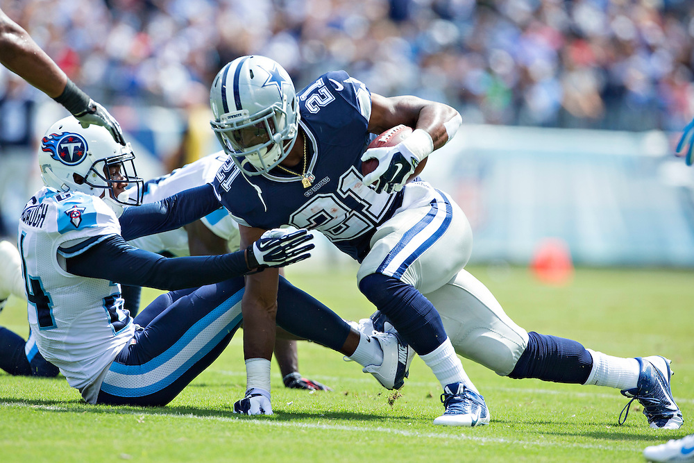 NASHVILLE, TN - SEPTEMBER 14:  Joseph Randle #21 of the Dallas Cowboys runs the ball against the Tennessee Titans at LP Field on September 14, 2014 in Nashville, Tennessee.  The Cowboys defeated the Titans 26-10.  (Photo by Wesley Hitt/Getty Images) *** Local Caption *** Joseph Randle