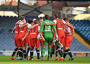 Macclesfield Towns players huddle during the The FA Cup match between Portsmouth and Macclesfield Town at Fratton Park, Portsmouth, England on 7 November 2015. Photo by Adam Rivers.