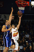 29th June 2002 at the Queens Wharf Events Centre in Wellington. Wellington Saints Brendon Polyblank tries to defend the lay up from Jets Jonathan Southey.<br />Pic: Sandra Teddy/Photosport<br />*digital image*