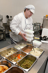In the Hospital Kitchens special dietary meals being put into polystyrene containers for specific inpatients ready for labelling ,