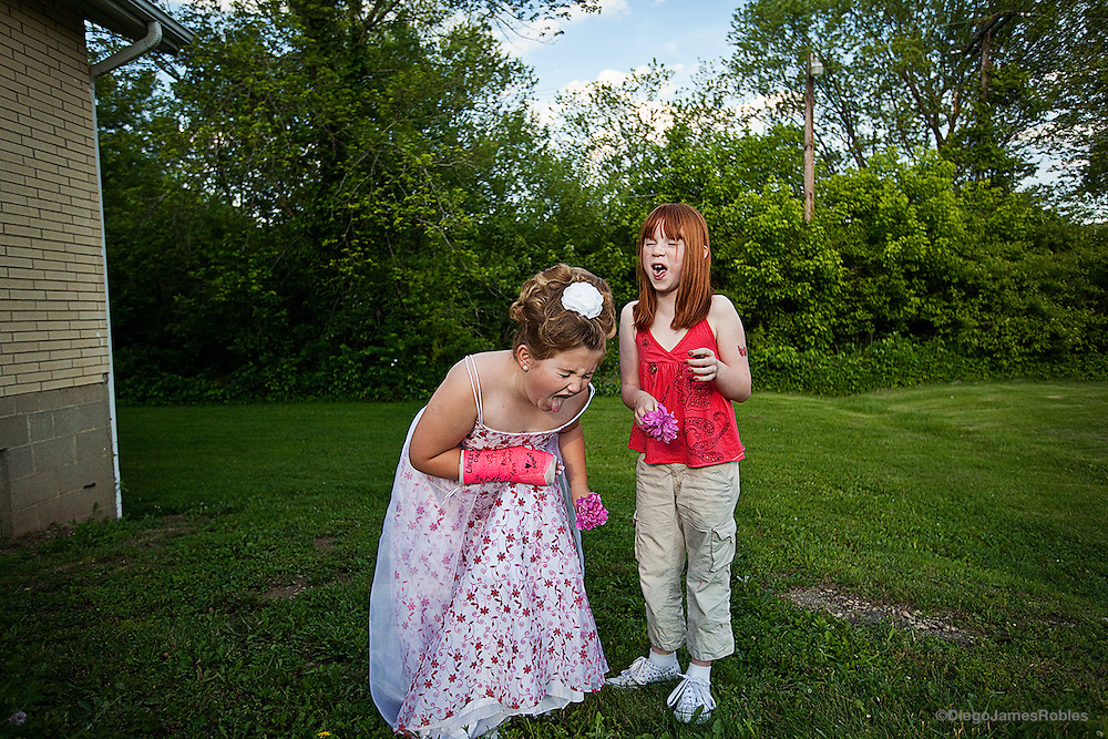 Right after her pageant interview on Friday afternoon, June 5, Hannah and her friend Samantha react after smelling a couple of flowers they picked. The day before the pageant, in Chauncey's Quaker House, all contestants recite a brief statement for a panel of judges and go through a five-minute interview.