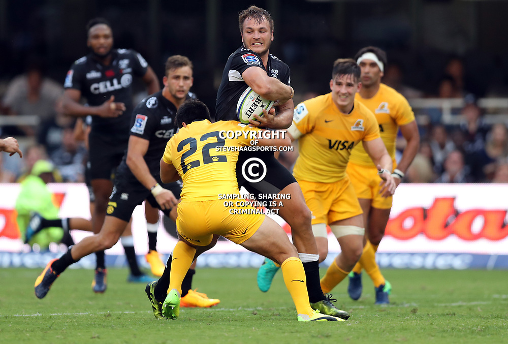 Santiago Gonzalez Iglesias of the Jaguares tackling Andre Esterhuizen of the Cell C Sharks during the Super Rugby match between the Cell C Sharks and the Jaguares  April 8th 2017 - at Growthpoint Kings Park,Durban South Africa Photo by (Steve Haag)