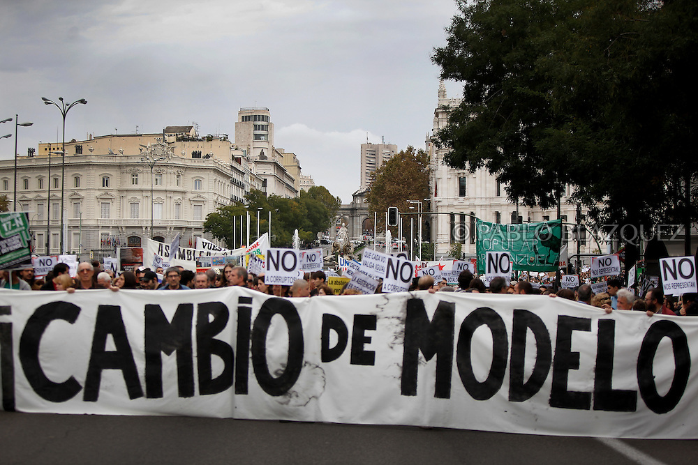 Spain's 'indignant' protesters march through the streets along Cibeles .Square holding a banner reading 'Change the model' on November 13, 2011in Madrid, Spain, to protest against spending cuts, high unemployment and political corruption, a week before a general election. Spain's so-called 'indignant' protest movement was born when thousands of people set up camp in Madrid's Puerta del Sol square ahead of May 22 municipal elections. (PABLO BLAZQUEZ)