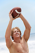 Young Man Catching Football