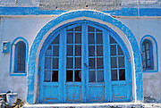 Thirasia Island (or Therasia), Santorini, Greece: arched cyan blue door with glass windows.