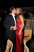 Arpad Busson and Elle Macpherson, Sir Elton John's White Tie and Tiara Ball. Windsor, 28 June 2003. © Copyright Photograph by Dafydd Jones 66 Stockwell Park Rd. London SW9 0DA Tel 020 7733 0108 www.dafjones.com