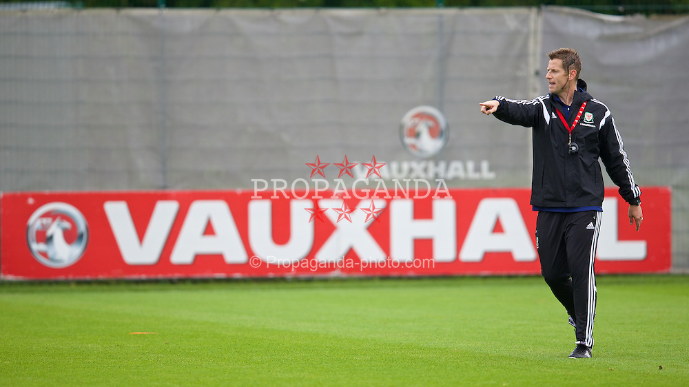 NEWPORT, WALES - Saturday, May 24, 2014: David Hughes gives a practical demonstration during the Football Association of Wales' National Coaches Conference 2014 at Dragon Park FAW National Development Centre. (Pic by David Rawcliffe/Propaganda)