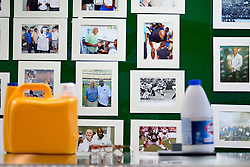Pictures on the wall remind of the football career of James Betterson, former Philadelphia Eagles Running Back and now owner of BetterClean Laundry in NorthEast Philadelphia, on February 15, 2019. Betterson, graduated of the free Power Up Your Business training program will testify next week in city council during a hearing to determine if the program will get extended funding. (Bastiaan Slabbers for WHYY)