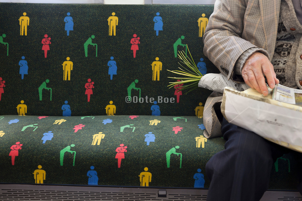 colorful handicap seat indication on a train in Japan