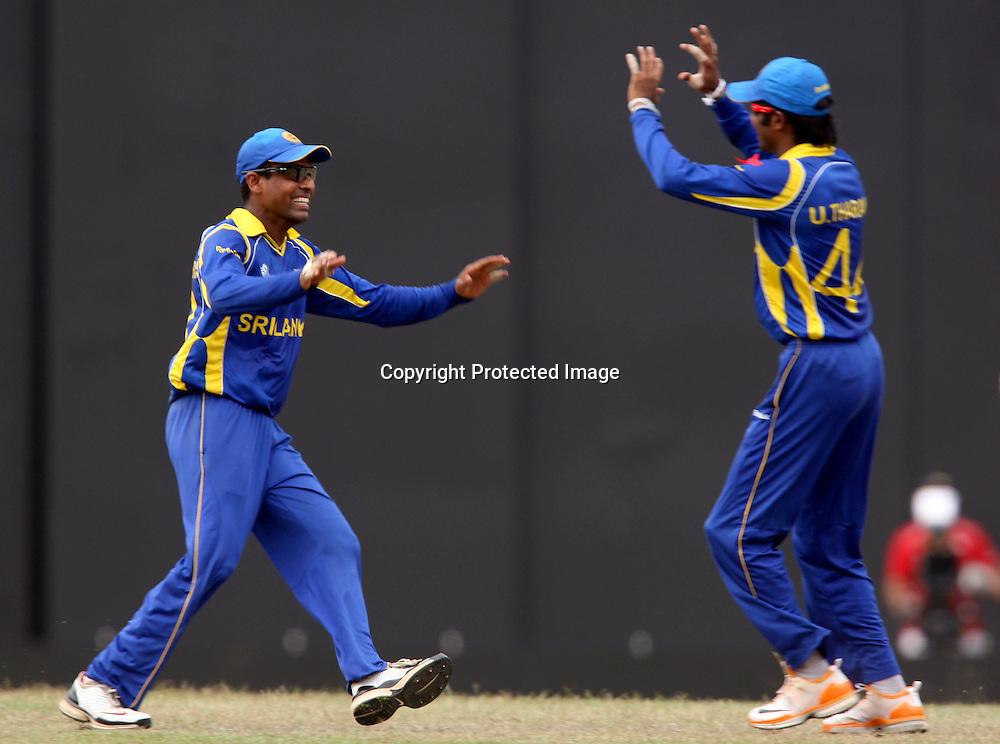 Sri Lankan players Thilan Samaraweera celebrates team mate England batsman Ian Bell catch during the ICC Cricket World Cup - 4th Quarter-Final Played at R Premadasa Stadium, Colombo.26 March 2011 - day/night (50-over match)