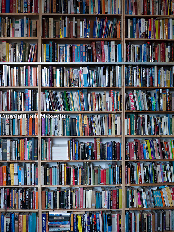 Rows of books on shelves in a secondhand bookstore in Berlin Germany