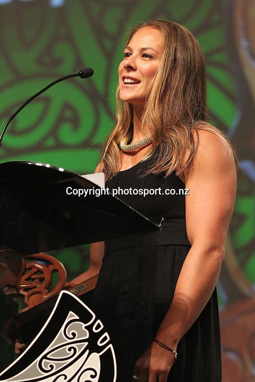 301113 2013  Jenny-May Coffin presents the award for senior Maori sportswoman to Lisa Carrington at the Trillian Trust Maori Sports Awards at Vodafone Events Centre, Manukau. Photo: Fiona Goodall/photosport.co.nz