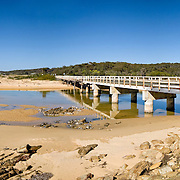Beach on southern NSW coast with bridge.