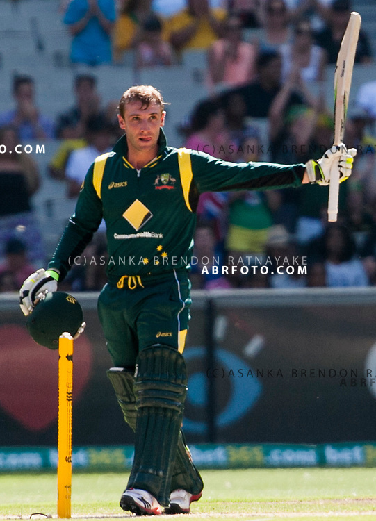 Phil Hughes raises his bat after reaching 50 batting during game 1 of the Commonwealth Bank Series Australia v Sri Lanka played at the Melbourne Cricket Ground in Melbourne,Victoria, Australia. Photo Asanka Brendon Ratnayake