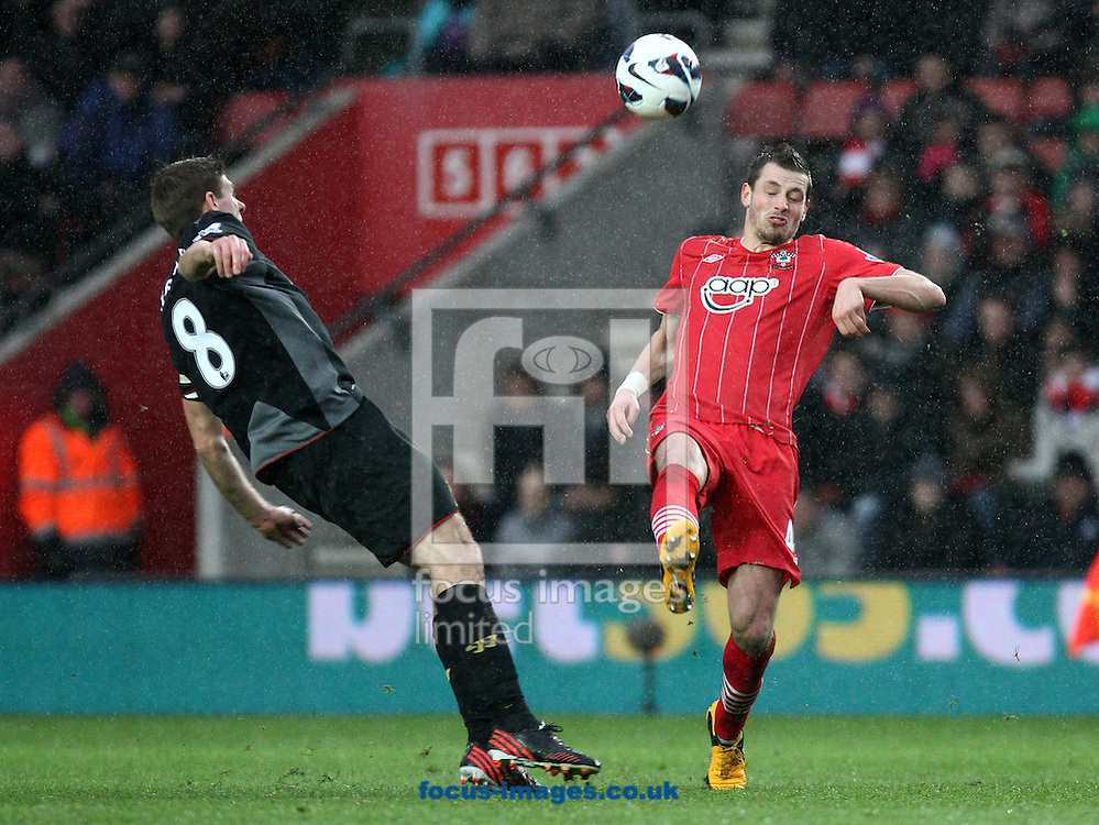 Picture by Daniel Chesterton/Focus Images Ltd +44 7966 018899.16/03/2013.Steven Gerrard of Liverpool and Morgan Schneiderlin of Southampton in action during the Barclays Premier League match at the St Mary's Stadium, Southampton.