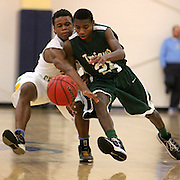 West Brunswick's Tyqun Hill battles with Harrells Christian's Marcus Scarborough for a loose ball on the first day of the Cape Fear Academy Holiday Basketball Tournament. (Jason A. Frizzelle)