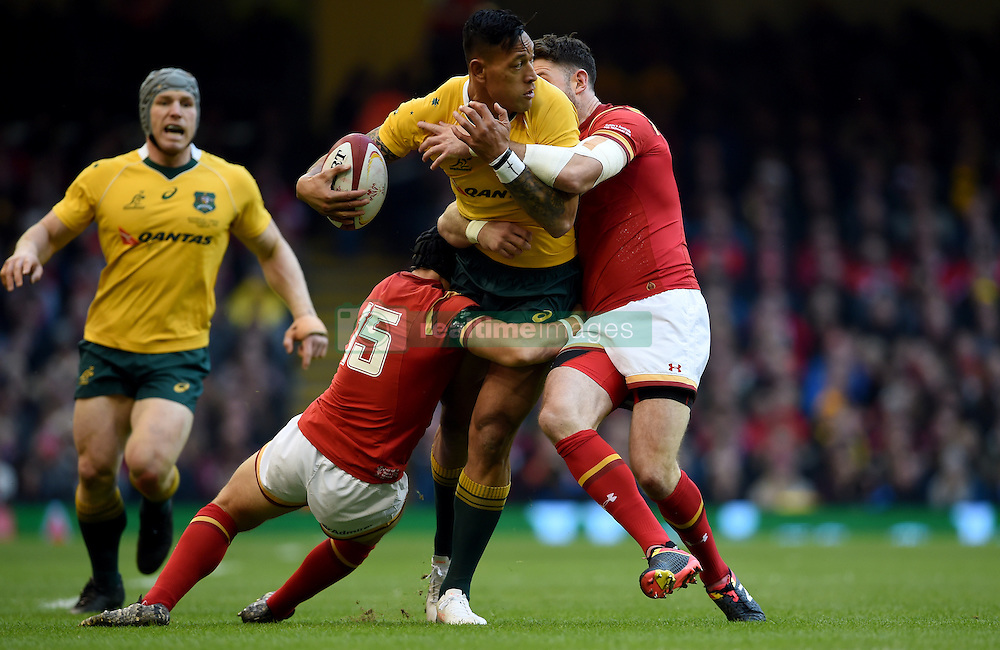 Australia's Israel Folau (centre) is tackled by Wales' Leigh Halfpenny (left) and Alex Cuthbert (right) during the Autumn International match at the Principality Stadium, Cardiff.