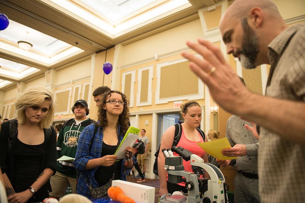 Brielle Robbins, center, and Helena McCoy, left, listen on as Ronan Carroll of the Physics and Astronomy Department, speaks during the 2016 Ohio University Majors Fair held at the Baker Center Ballroom on Wednesday, September 14, 2016.