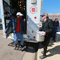 Curt McLellan, right, drops off a pot full of Chicken and Dumplings Soup from the Local Mobile food truck as part of the Empty Bowl Luncheon fundraiser for The Salvation Army.