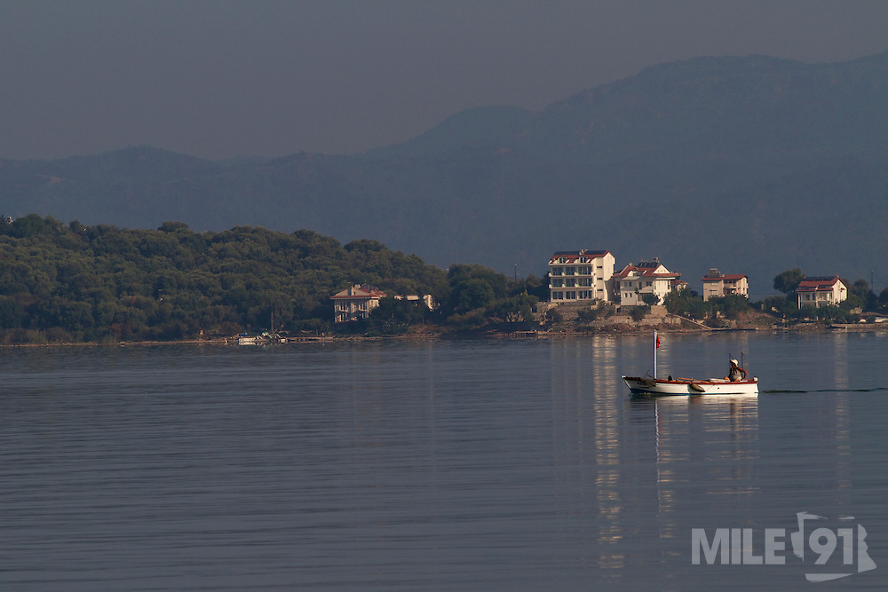 A small boat heads across the bay in the early morning, Turkey.