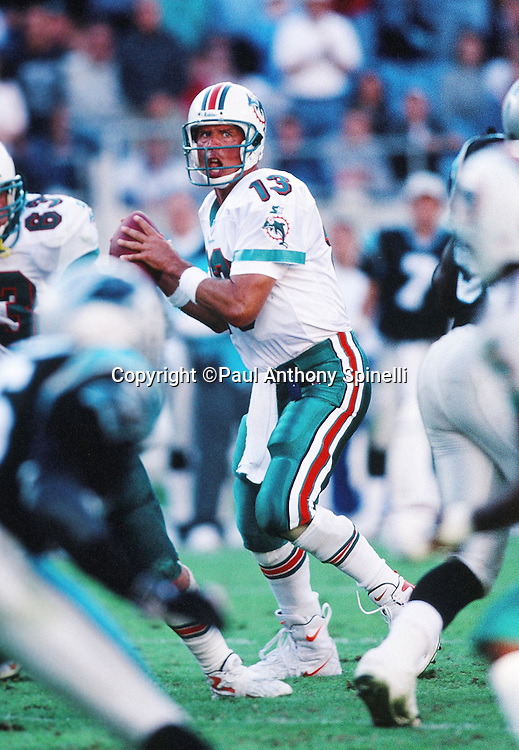 Miami Dolphins quarterback Dan Marino (13) drops back to pass during the NFL football game against the Carolona Panthers on Nov. 15, 1998 in Charlotte, N.C. The Dolphins won the game 13-9. (©Paul Anthony Spinelli)