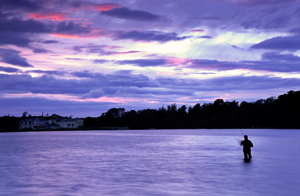 After sunset, at Loch Leane, a lone angler tries to get some catch. Angling is forbidden in Ireland unless you have a permit