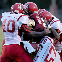 Ashley's Daniel Andrews is tackled by Hoke County's Sean Smaugh, left, Donovan Wirt, center, Quientin Etheridge, right, Jamal Darden, back left, and Justin Baldwin. (Jason A. Frizzelle) This collection of images is from the 2013 High School Football in the Cape Fear region.