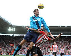 Stoke's Peter Crouch beats Southampton's Saphir Taider to the header - Photo mandatory by-line: Dougie Allward/JMP - Mobile: 07966 386802 - 25/10/2014 - SPORT - Football - Southampton - ST Mary's Stadium - Southampton v Stoke - Barclays Premier League