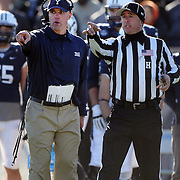 Tony Reno, Yale Bulldogs football, Head Coach,  discusses a refereeing decision with an official during the Yale Vs Princeton, Ivy League College Football match at Yale Bowl, New Haven, Connecticut, USA. 15th November 2014. Photo Tim Clayton