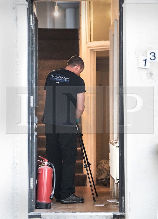 © Licensed to London News Pictures. 21/09/2017. London, UK. A police forensics officer takes photographs in the hallway of a property in Thornton Heath, south London where a 17 year old was arrested last night. This is the sixth arrest in connection with the bombing of an underground train at Parsons Green on September 15th. The bomb failed to fully explode but still injured 30 people. Photo credit: Peter Macdiarmid/LNP